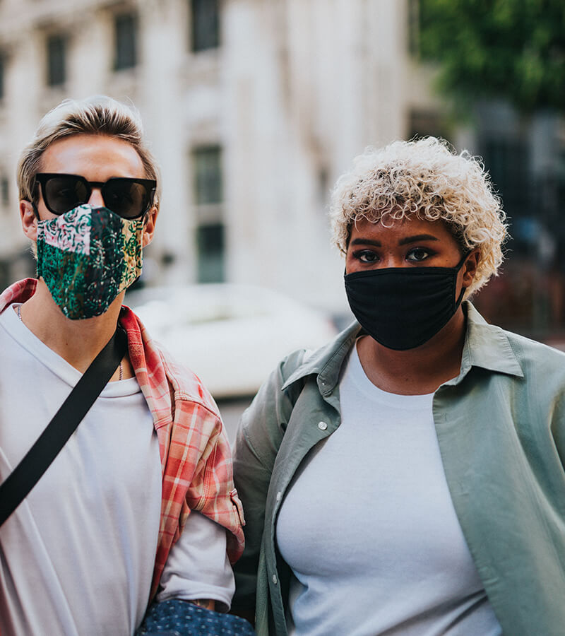 Covid Resources - Two young people wearing face masks